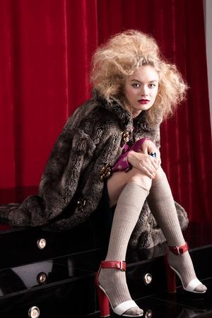 Beautiful blond woman in a fur. studio shot photo