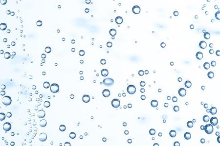 水はすぐに多くの泡、泡と水の波を抽象化します。