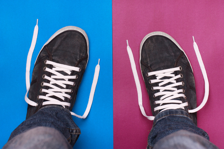 stylish blue gym shoes with white laces on a color background photo