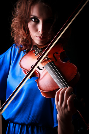 woman violin: Music portrait of young woman.  Violin play. Close up face beautiful model.