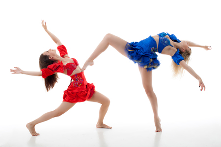 two women dance on a white background. studio shot photo