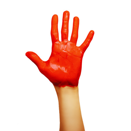 hand in red paint. isolated on white background photo