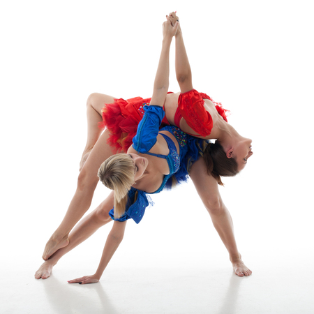 choreographer: two women dance on a white background. studio shot