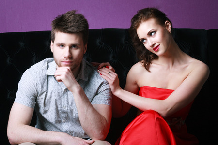 couple posing on colorful background. studio shot photo