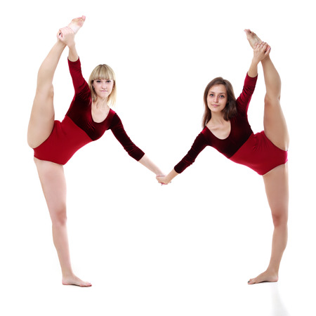 two women dance on a white background. studio shot photo