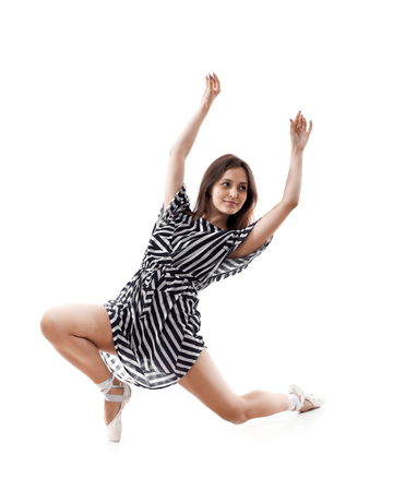 Woman performing a dance against a white  Stock Photo