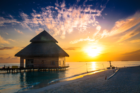 Sunset on Maldives island, water villas resort photo