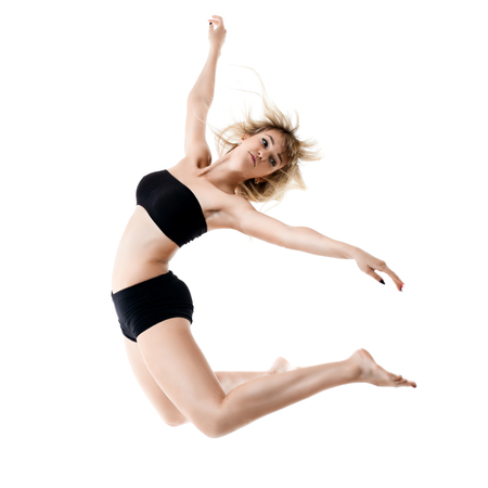 Woman performing a dance against a white background