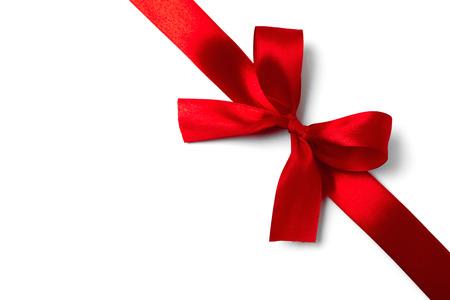 Shiny red satin ribbon on white background. studio shot Stock Photo - 32747631
