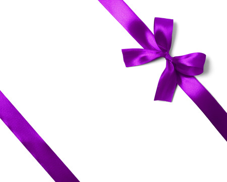 Shiny purple satin ribbon on white background. studio shot