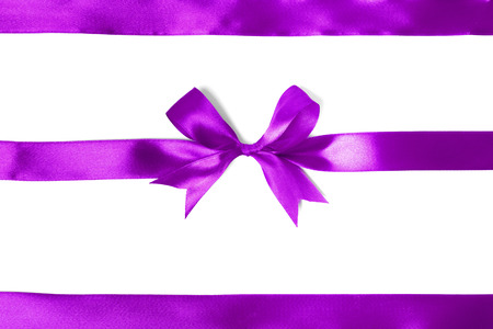 Shiny purple satin ribbon on white background. studio shot photo