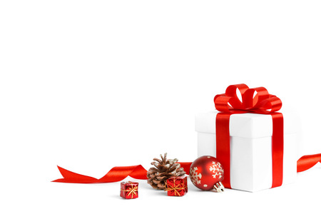 feliz navidad: christmas gift with red balls bow isolated on white background