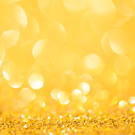gold decorations: Gold spring or summer background. Elegant abstract background with bokeh defocused lights Stock Photo