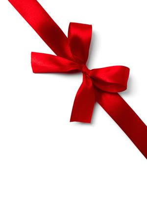 Red ribbon bow on white background. studio shot Stock Photo