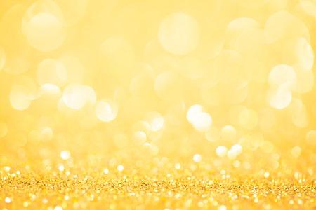 Decorative yellow christmas background with bokeh lights. studio shot 免版税图像