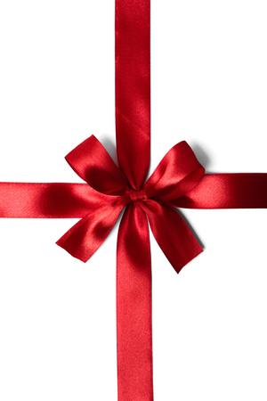 Shiny red satin ribbon on white background. studio shot
