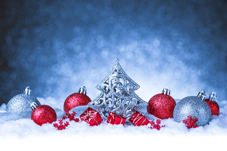 red and blue: christmas ornament in snow on glitter background. studio shot Stock Photo