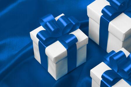 blue silk: gift on blue satin background. studio shot Stock Photo