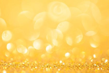 Gold spring or summer background. Elegant abstract background with bokeh defocused lights Stock Photo