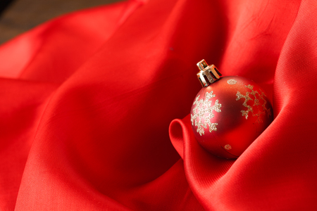 Small red decoration balls over red silk background photo