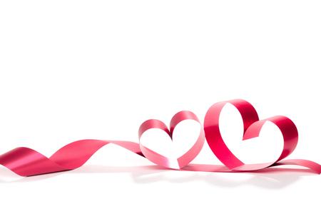 Valentine Heart. Elegant Red satin gift Ribbon. Isolated on white