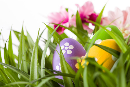 Easter colored eggs on the green grass. photo