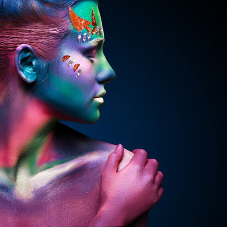 alien face: Portrait of beautiful woman with body art Stock Photo