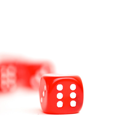 rolling dice: rolling red dice isolated on white Stock Photo