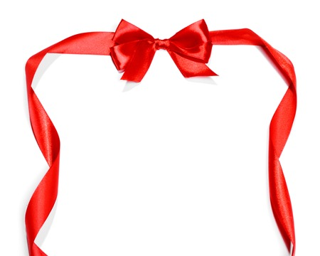 Red ribbons with bow with tails isolated on white background Stock Photo