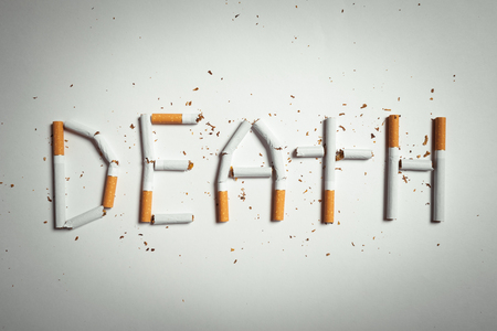 affects: word DEATH, made of cigarettes. studio shot