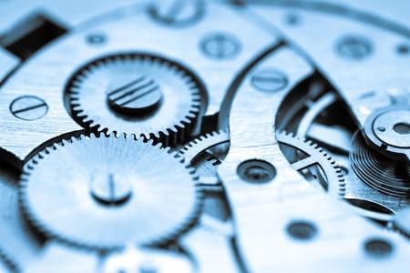 mecanica industrial: mecanismo de reloj hecho en la t�cnica de tonificaci�n. Muy poca profundidad de campo. Centrarse en los engranajes centrales Foto de archivo