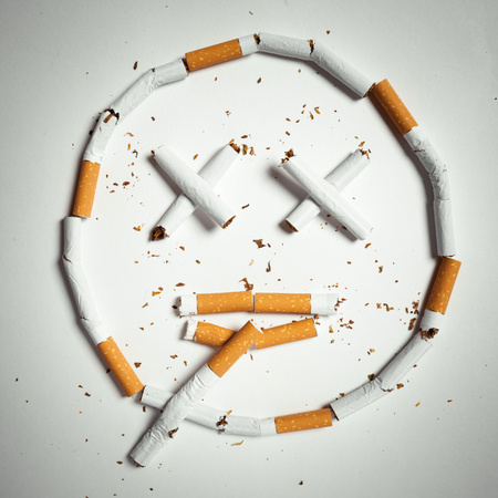 affects: smile, made of cigarettes on white background. studio shot