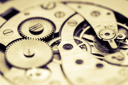 Mechanism of pocket watch with grunge texture. Stock Photo