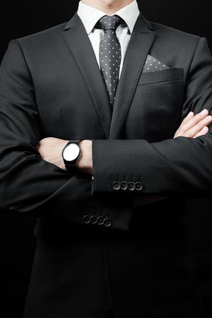 man in tie on a black background. studio shot