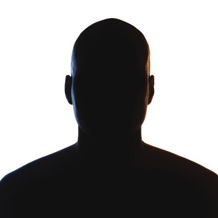未知の男性人のシルエット。分離されたバック点灯スタジオ 写真素材