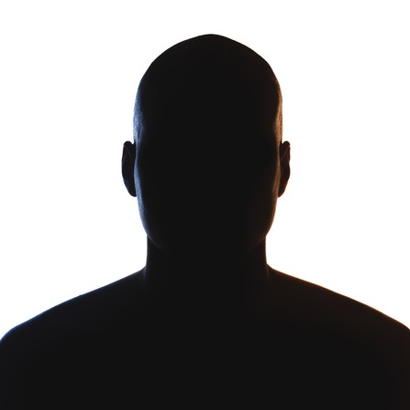 Onbekende mannelijke persoon silhouet. Terug geïsoleerd aangestoken studio Stockfoto - 43715318