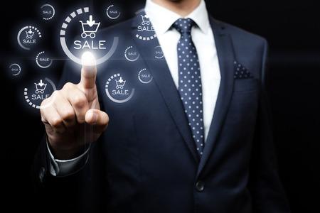 businessman pressing sales team button on virtual screens Archivio Fotografico
