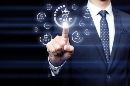 team success: businessman pressing sales team button on virtual screens Stock Photo