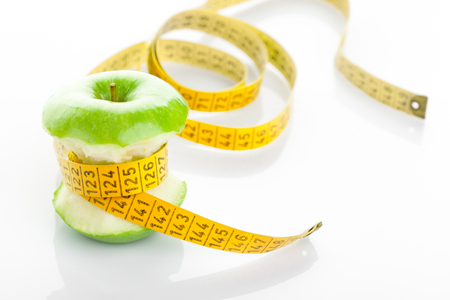 apple core: Green apple core and measuring tape