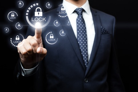 virtual technology: business, technology and internet concept - businessman pressing button on virtual screens Stock Photo