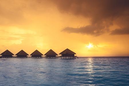 maldives island: Sunset on Maldives island, water villas resort Stock Photo