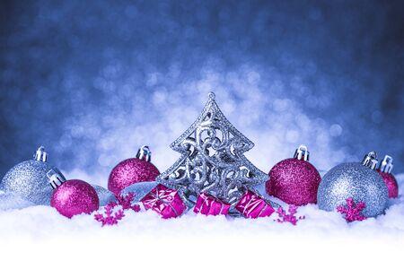 christmas baubles of modern design: christmas ornament in snow on glitter background. studio shot Stock Photo