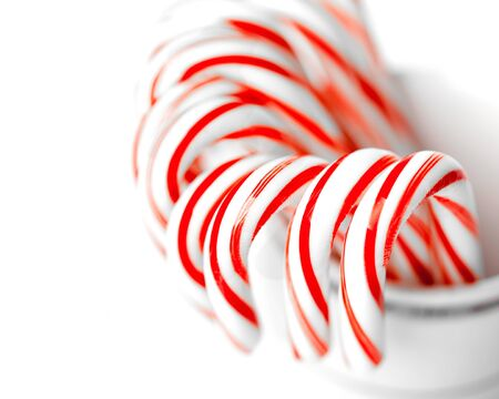 peppermint candy: Festive Red and White Peppermint Candy Canes. studio shot