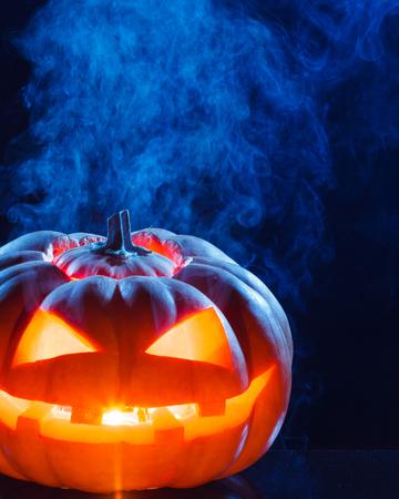 hollows: Halloween - terrible pumpkin on black background. studio shot Stock Photo