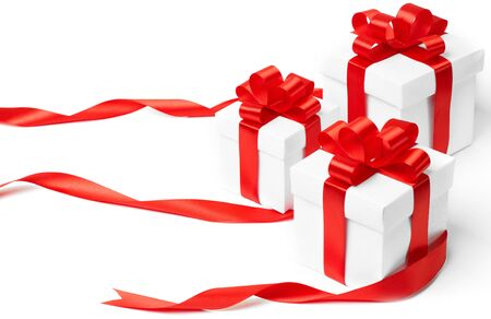 ribbon bow: White gift box with red ribbon bow and christmas balls around, isolated on white background Stock Photo