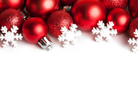 赤い飾りとクリスマスの国境 写真素材