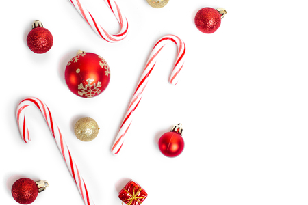canes: A lot of christmas candies and balls isolated on white background