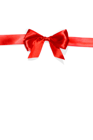 christmas border: Red ribbons with bow with tails isolated on white background Stock Photo