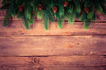 Vintage frame from branch of Christmas tree on old wood