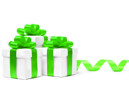 ribbon bow: White gift boxes with green ribbon bow and christmas balls around, isolated on white background Stock Photo